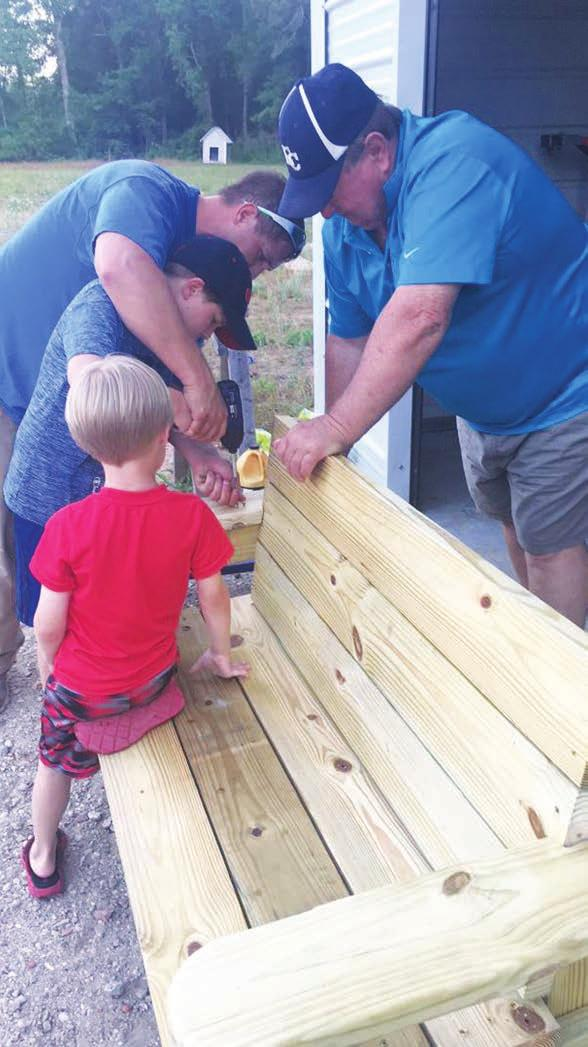 THE SUMTER ITEM FRIDAY, JUNE 8, 2018 A7 THE CLARENDON SUN Buddy Benches will help teach children to be kind PHOTOS PROVIDED Colin Myers helps his father, Nick Myers, build a Buddy Bench as his