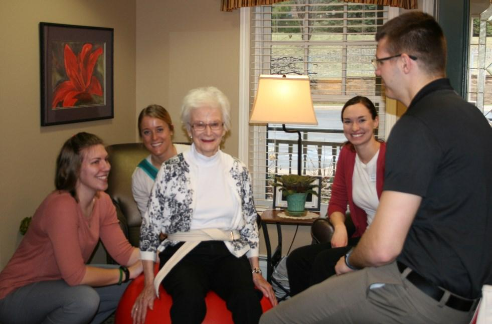 A graduate level therapy student and an undergraduate student are paired with an Assisi resident.