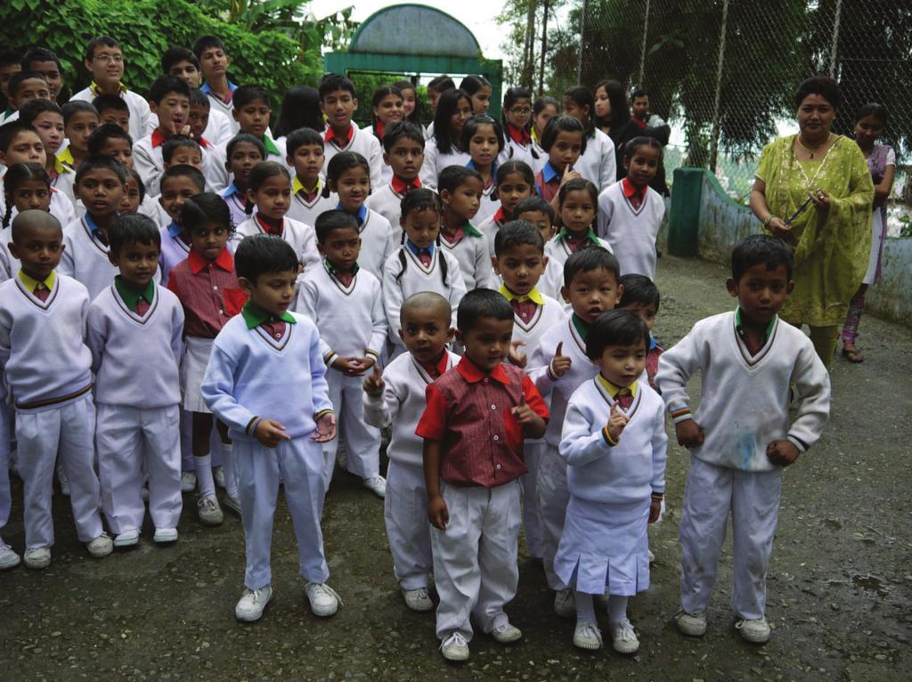 7 Question 6 Religion and Young People Look at the photograph below, which shows children at a faith school in India.
