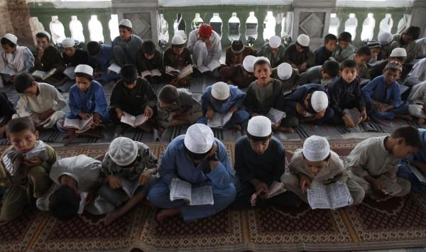 Boys reading the Qur an
