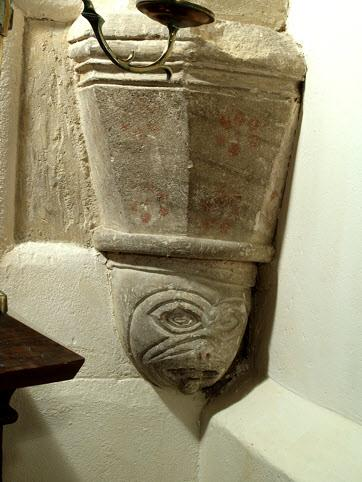 A 12th century tub font, the 12th century nave and 12th century chancel,
