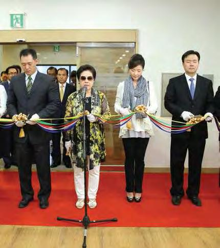 History and Scale of the Archives True Mother cutting the tape with her Kwon Jin Nim, Sun Jin nim and In Sup nim children and son-in-law Director Seog Byung's Kim progress report, accompanied by a