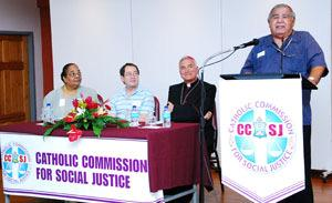 Left to right: CCSJ s Chair, Hon.