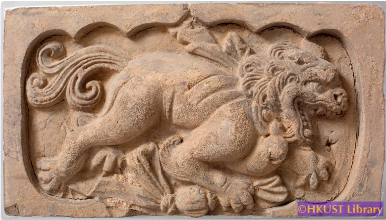 A Grey Pottery Brick Carving of a Lion