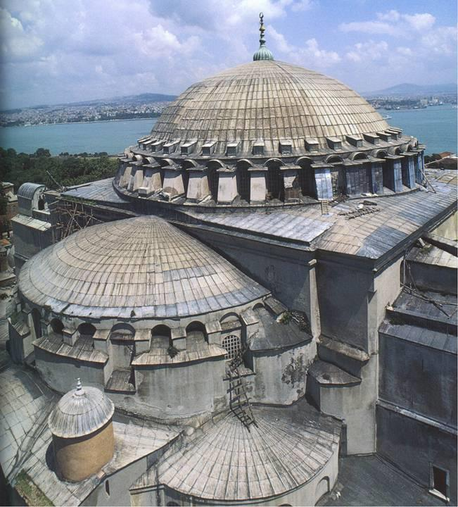 At Hagia Sophia, two opposing arches on the central square open into semi domes, each pierced by 3 smaller radial semidomes.
