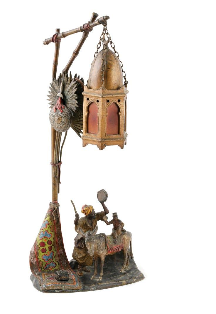 Anton Chotka (Austrian1875-1925) Cold-painted bronze lamp with figural group of a man with a monkey riding a donkey.