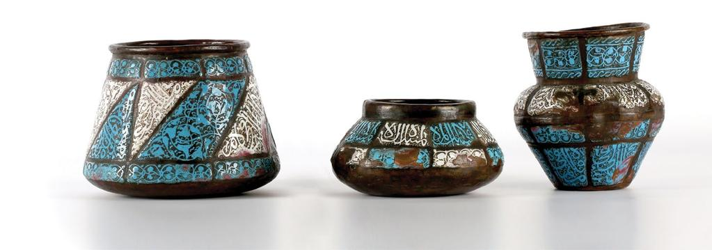 "A pair of Sarraf Enamel Mina Copper Basins وعاءان نحاسيان ""مطليان باملينا"" من الصراف decorated with floral and foliage motifs galzed in blue, green, pink and white."