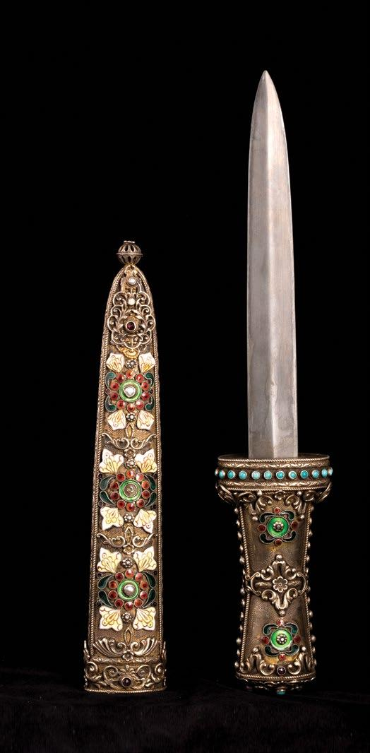 131 Russian Orientalist Letter Opener فتاحة رسائل روسية من الفن اإلستشراقي With turquoise stones inlaid in the handle. Green foliate, red circle, yellow and white quatrefoil enameling.