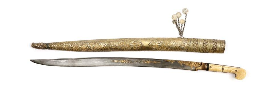 Damask watered-steel patterned blade with seven different length grooves. Hilt with ivory grip scales and shim comprising gold gilt band decorations. In its skin scabbard.