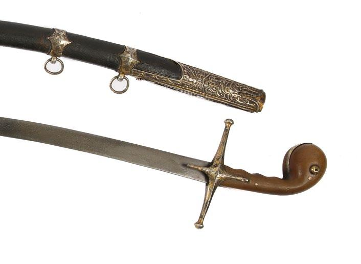 The Rhino horn hilt with rounded pommel and gold plated quillons engraved with fine floral pattern.