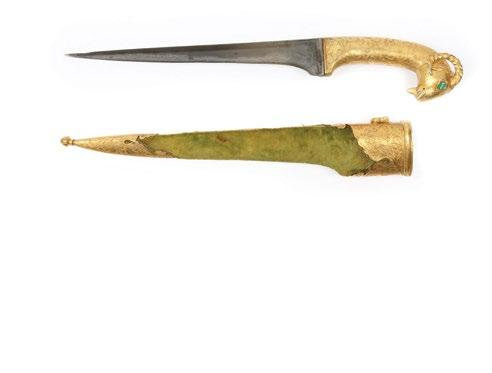 The pommel in the shape of an animal head. The dagger with a straight blade and overall foliate gold overlay and with script on the forte.