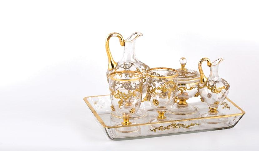 A 5 piece St-Louis glass set طقم سانت لويس مكون من 5 قطع with two glasses, sugar bowl and two pitchers, with gilt painted scrolling foliate decoration and applied glass gilded flowers.