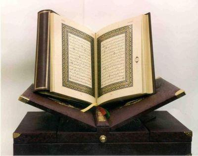 4. The Qur an a. Islamic holy text b.